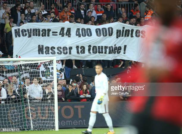 'Neymar 44 400 000 pints Nasser your round' funny banner to President of PSG Nasser AlKhelaifi from the supporters of Guingamp during the French...