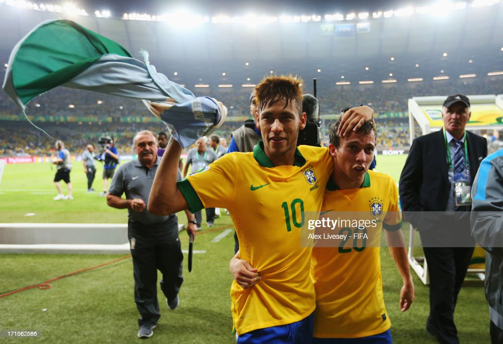 Neymar and Bernard of Brazil (R) celebrate at the end of the FIFA Confederations Cup Brazil 2013 Semi Final match between Brazil and Uruguay at Governador Magalhaes Pinto Estadio Mineirao on June 26, 2013 in Belo Horizonte, Brazil.