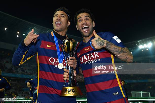 Neymar and Dani Alves of Barcelona hold the Winner's Trophy during the FIFA Club World Cup Japan 2015 Final between River Plate and FC Barcelona at...