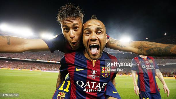 Neymar and Dani Alves of FC Barcelona celebrate after winning the Copa del Rey Final between Athletic Club and FC Barcelona at Camp Nou on May 30...