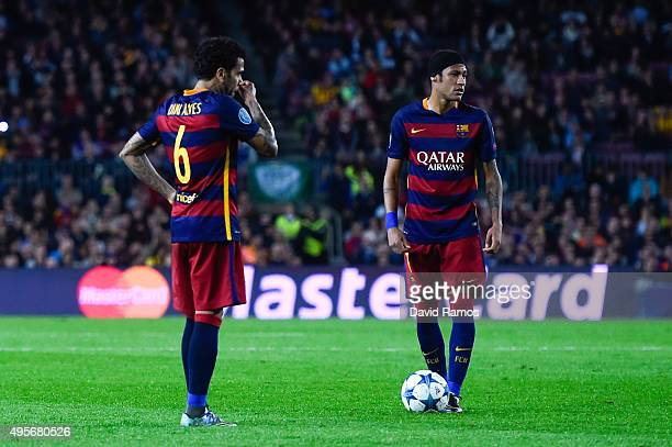 Neymar and Dani Alves of FC Barcelona prepare to take a free kick during the UEFA Champions League Group E match between FC Barcelona and FC BATE...