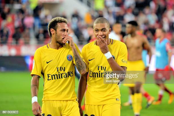 Neymar and Kylian Mbappe of PSG at the end during the Ligue 1 match between Dijon FCO and Paris Saint Germain at Stade Gaston Gerard on October 14...