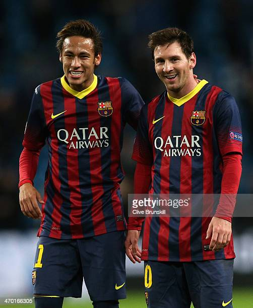 Neymar and Lionel Messi of Barcelona walk off in good spirits following their team's victory at the end of the UEFA Champions League Round of 16...