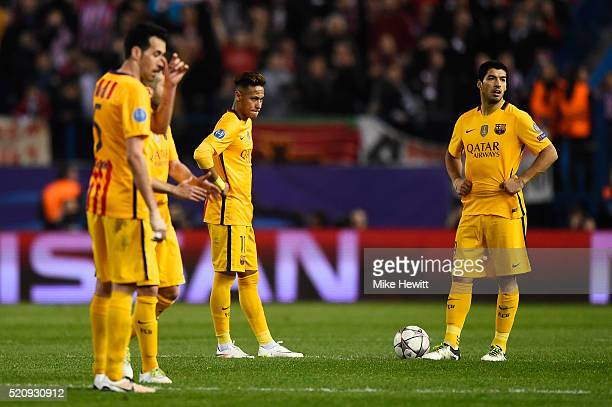 Neymar and Luis Suarez of Barcelona look dejected during the UEFA Champions League quarter final second leg match between Club Atletico de Madrid and...