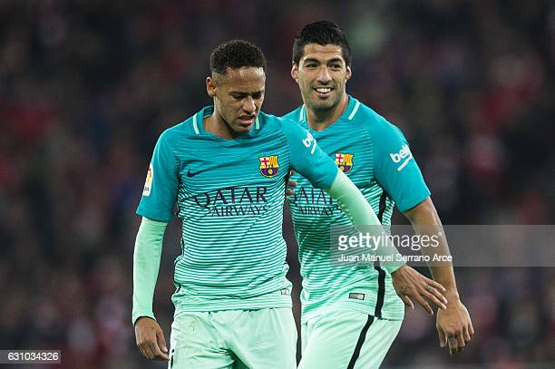 Neymar and Luis Suarez of FC Barcelona react during the Copa del Rey Round of 16 first leg match between Athletic Club and FC Barcelona at San Mames...