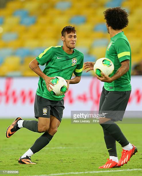 Neymar and Marcelo of Brazil in action during a training session ahead of their FIFA Confederations Cup Brazil 2013 Final match against Spain at the...