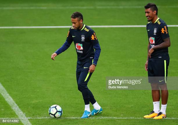 Neymar and Paulinho take part in a training session at the Arena do Gremio on August 30 2017 in Porto Alegre Brazil ahead of their 2018 FIFA World...