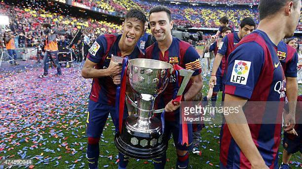 Neymar and Xavi Hernandez of FC Barcelona pose with La Liga trophy during the La Liga match between FC Barcelona and RC Deportivo La Coruña at Camp...