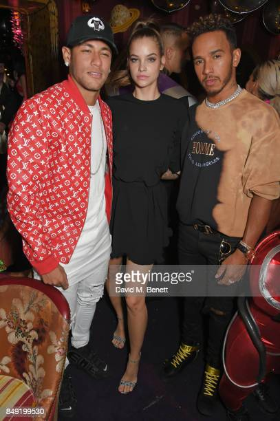 Neymar Barbara Palvin and Lewis Hamilton attend the LOVE magazine x Miu Miu party held during London Fashion Week at Loulou's on September 18 2017 in...
