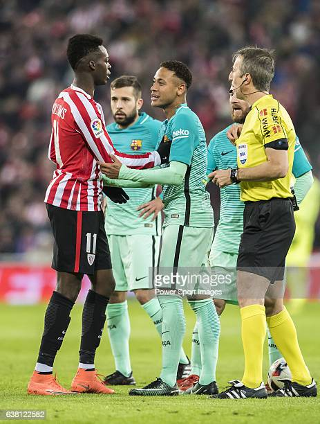 Neymar da Silva Santos Junior of FC Barcelona argues with Inaki Williams Arthuer of Athletic Club as referee David Fernandez Borbalan looks on during...