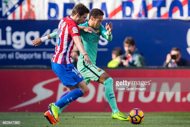 Neymar da Silva Santos Junior of FC Barcelona battles for the ball with Sime Vrsaljko of Atletico de Madrid during their La Liga match between...
