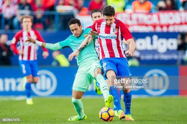 Neymar da Silva Santos Junior of FC Barcelona competes for the ball with Sime Vrsaljko of Atletico de Madrid during their La Liga match between...