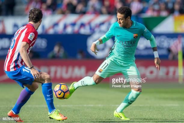 Neymar da Silva Santos Junior of FC Barcelona fights for the ball with Sime Vrsaljko of Atletico de Madrid during their La Liga match between...