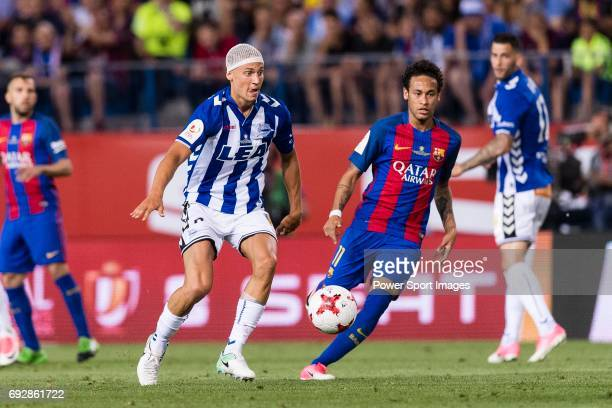 Neymar da Silva Santos Junior of FC Barcelona fights for the ball with Marcos Llorente of Deportivo Alaves during the Copa Del Rey Final between FC...