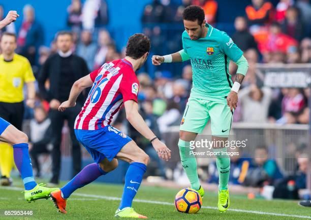 Neymar da Silva Santos Junior of FC Barcelona is challenged by Sime Vrsaljko of Atletico de Madrid during their La Liga match between Atletico de...