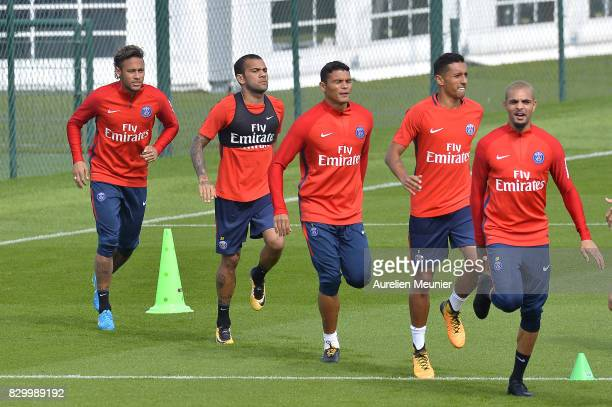 Neymar Dani Alves Thiago Silva Marquinhos and Layvin Kurzawa warm up before a training session with the Paris SaintGermain on August 11 2017 in Paris...