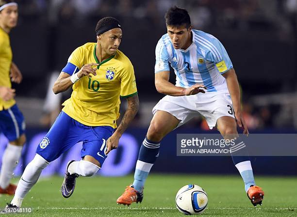 Neymar from Brazil tries to elude Argentina's Facundo Roncaglia during their Russia 2018 FIFA World Cup South American Qualifiers football match in...