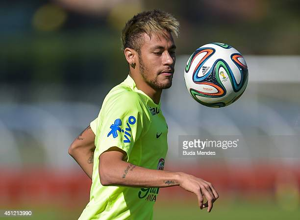 Neymar in action during a training session of the Brazilian national football team at the squad's Granja Comary training complex on June 25 2014 in...