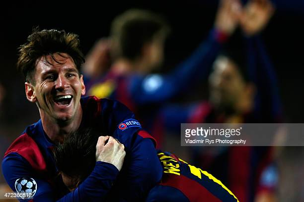 Neymar is celebrated by his team mate Lionel Messi of Barcelona after scoring his team's third goal during the first leg of UEFA Champions League...