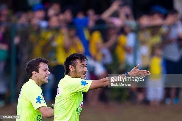 Neymar jokes with a Bernard during a training session of the Brazilian national football team at the squad's Granja Comary training complex in...