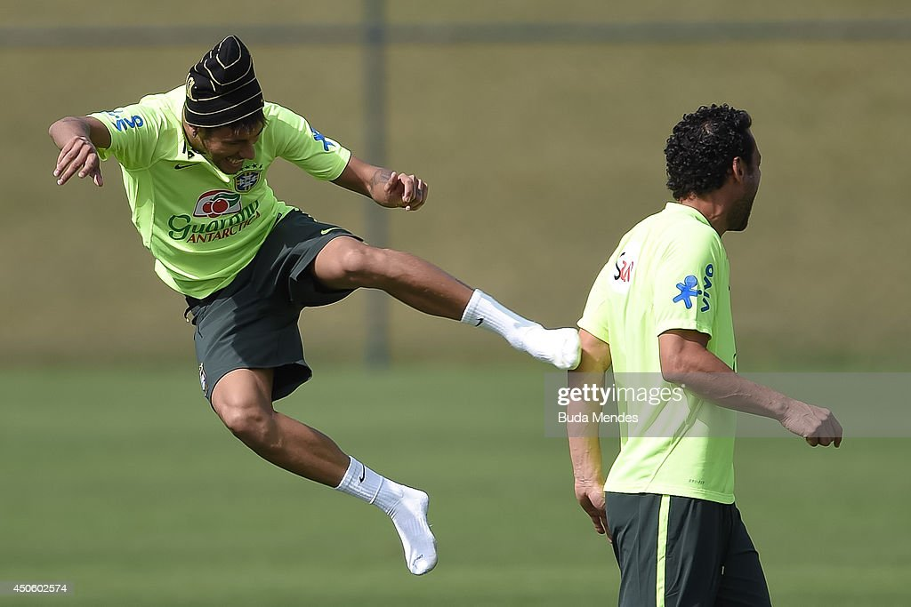 Neymar jokes with a Fred during a training session of the Brazilian national football team at the squad's Granja Comary training complex, on June 14, 2014 in Teresopolis, 90 km from downtown Rio de Janeiro, Brazil.
