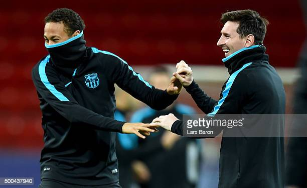 Neymar jokes with Lionel Messi during a FC Barcelona training session on the eve of the UEFA Champions League groupe E match against Bayer Leverkusen...