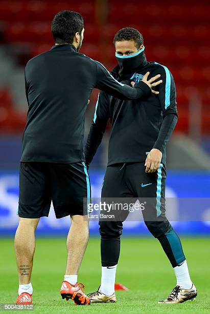 Neymar jokes with Luis Suarez during a FC Barcelona training session on the eve of the UEFA Champions League groupe E match against Bayer Leverkusen...