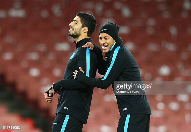 Neymar jokes with Luis Suarez of Barcelona during a FC Barcelona training session ahead of their UEFA Champions League round of 16 first leg match...