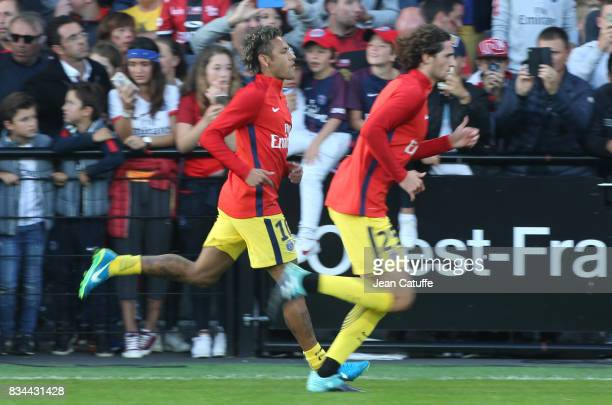 Neymar Jr and Adrien Rabiot of PSG warm up before the French Ligue 1 match between En Avant Guingamp and Paris Saint Germain at Stade de Roudourou on...