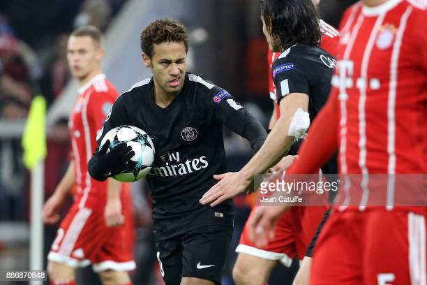 Neymar Jr and Edinson Cavani of PSG celebrate the goal of Kylian Mbappe during the UEFA Champions League group B match between Bayern Muenchen and...