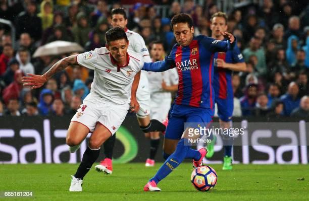 Neymar Jr and Kranevitter during La Liga match between FC Barcelona v Sevilla CF in Barcelona on April 05 2017