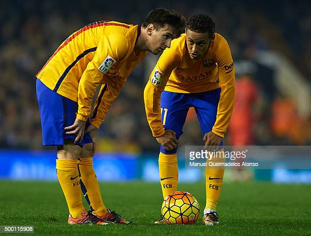 Neymar JR and Lionel Messi of Barcelona speak during the La Liga match between Valencia CF and FC Barcelona at Estadi de Mestalla on December 05 2015...