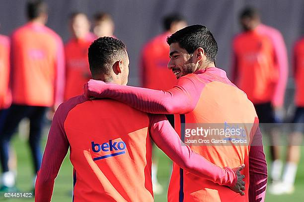 Neymar Jr and Luis Suárez attend a training session at the Sports Center FC Barcelona Joan Gamper before the Spanish League match between FC...