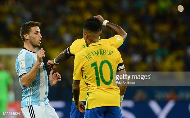 Neymar Jr and Paulinho of Brazil argue with Lucas Biglia of Argentina during a match between Argentina and Brazil as part of FIFA 2018 World Cup...