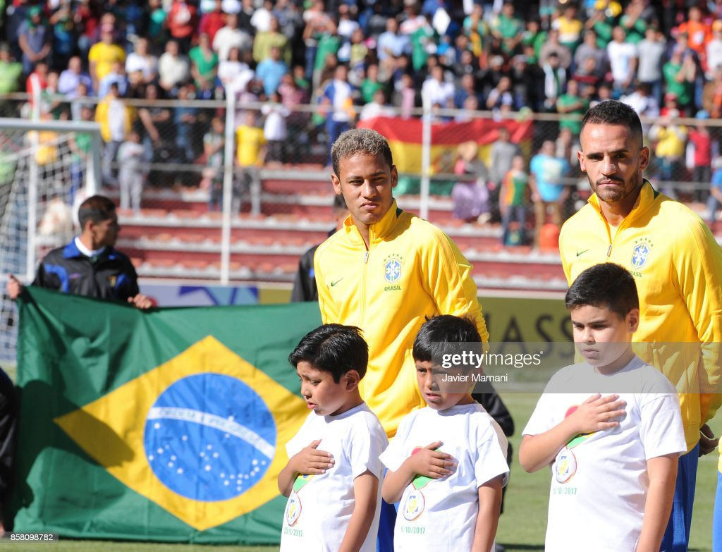 Neymar Jr. and Renato Augusto of Brazil line up prior to a match between Bolivia and Brazil as part of FIFA 2018 World Cup Qualifiers at Hernando Siles Stadium on October 05, 2017 in La Paz, Bolivia.