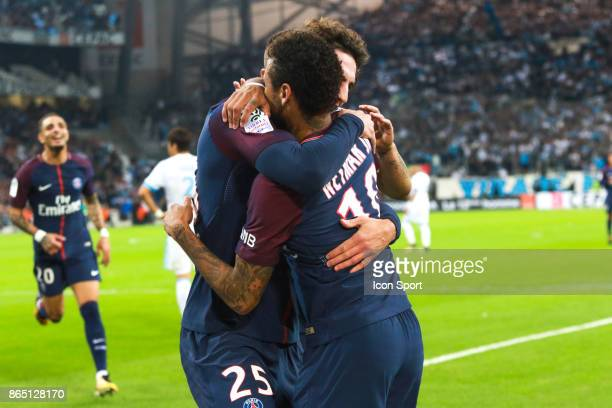 Neymar Jr and Thomas Meunier of PSG celebrate his goal during the Ligue 1 match between Olympique Marseille and Paris Saint Germain at Stade...