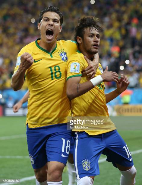 Neymar JR celebrates scoring a penalty with Hernanes during the opening match of the 2014 World Cup between Brazil and Croatia at Arena de Sao Paulo...