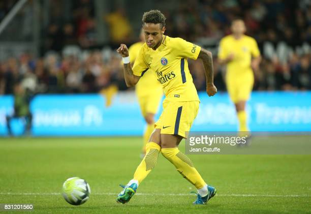 Neymar Jr delivers the ball to Edinson Cavani who scores the second goal during the French Ligue 1 match between En Avant Guingamp and Paris Saint...