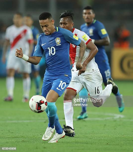 Neymar Jr drives the ball as Pedro Aquino of Peru chases during a match between Peru and Brazil as part of FIFA 2018 World Cup Qualifiers at Nacional...