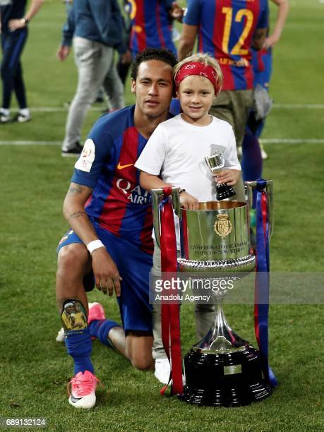 Neymar JR of Barcelona celebrates with the trophy after the Copa Del Rey Final between FC Barcelona and Deportivo Alaves at Vicente Calderon Stadium...