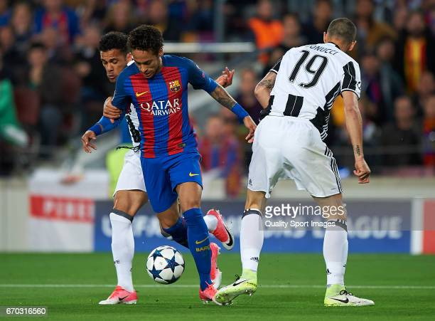 Neymar Jr of Barcelona competes for the ball with Daniel Alves and Leonardo Bonucci of Juventus during the UEFA Champions League Quarter Final second...