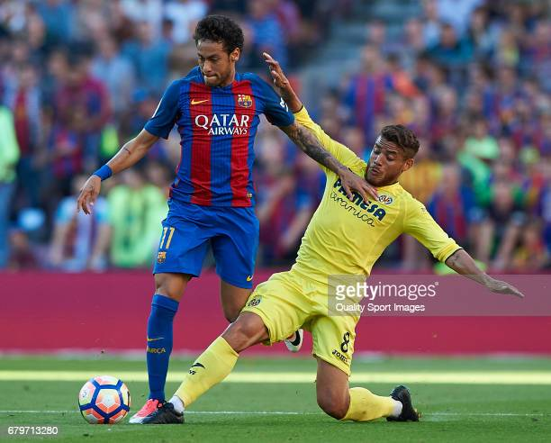 Neymar Jr of Barcelona competes for the ball with Jonathan Dos Santos of Villarreal during the La Liga match between FC Barcelona and Villarreal CF...
