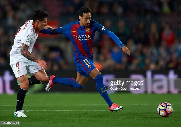 Neymar Jr of Barcelona competes for the ball with Matias Kranevitter of Sevilla during the La Liga match between FC Barcelona and Sevilla FC at Camp...