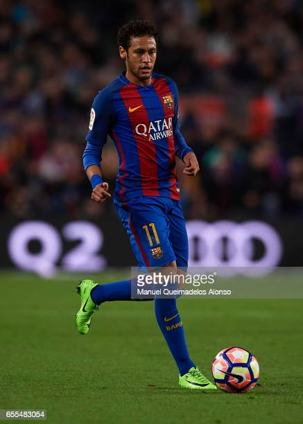 Neymar JR of Barcelona runs with the ball during the La Liga match between FC Barcelona and Valencia CF at Camp Nou Stadium on March 19 2017 in...