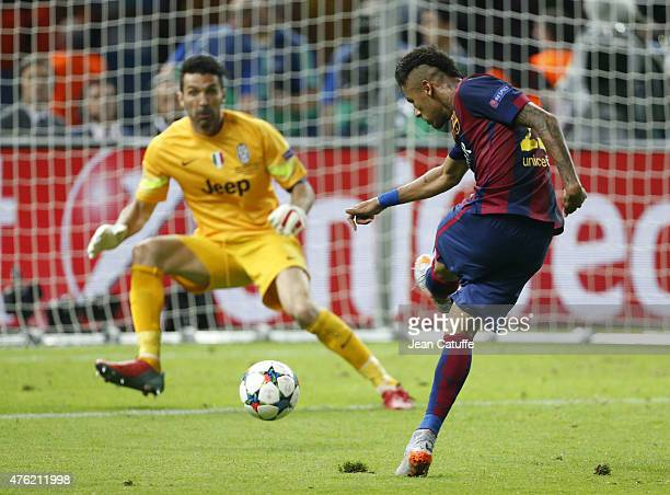 Neymar Jr of Barcelona scores the third goal against goalkeeper Gianluigi Buffon of Juventus Turin during the UEFA Champions League Final between...