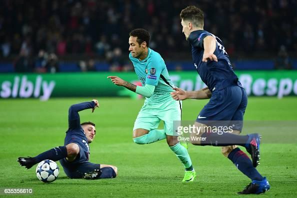Neymar Jr of Barcelona slips between Marco Verratti of PSG and Thomas Meunier of PSG during the Champions League match between Paris Saint Germain...