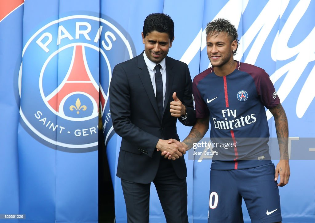 Neymar Jr of Brazil - here with President of PSG Nasser Al-Khelaifi - during press conference and jersey presentation following his signing as new player of Paris Saint-Germain at Parc des Princes on August 4, 2017 in Paris, France.