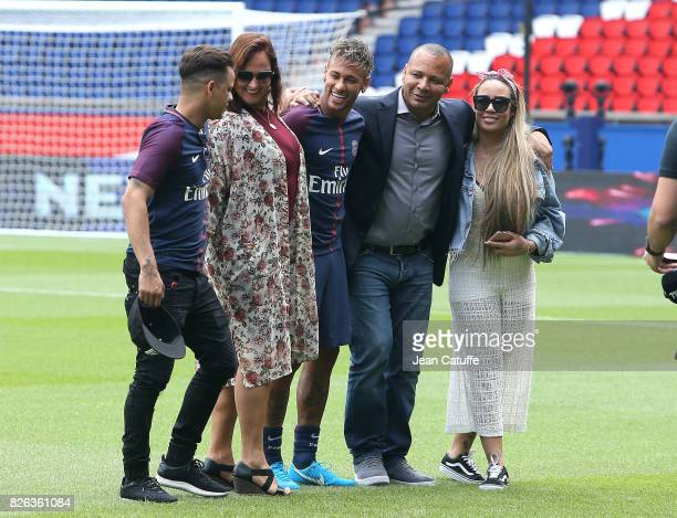 Neymar Jr of Brazil poses with his best friend Jo Amancio his mother Nadine Santos his father Neymar Sr Santos his sister Raffaela Santos Beckran...
