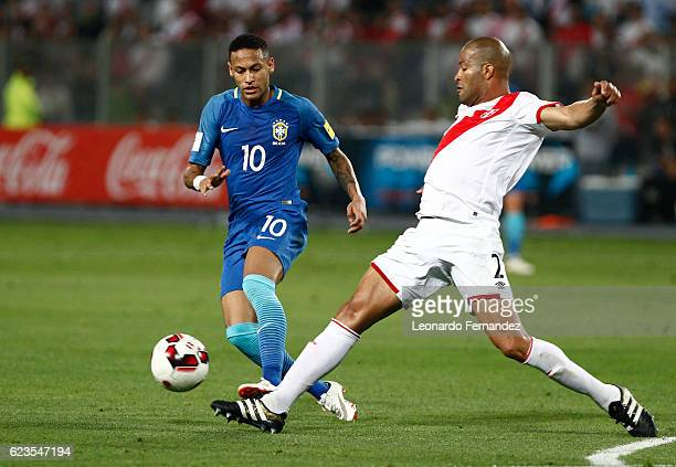 Neymar Jr of Brazil struggles for the ball with Alberto Rodriguez of Peru during a match between Peru and Brazil as part of FIFA 2018 World Cup...