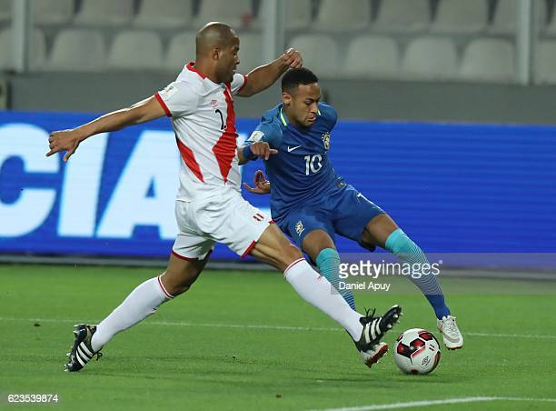 Neymar Jr of Brazil tries to dribble Alberto Rodriguez of Peru during a match between Peru and Brazil as part of FIFA 2018 World Cup Qualifiers at...